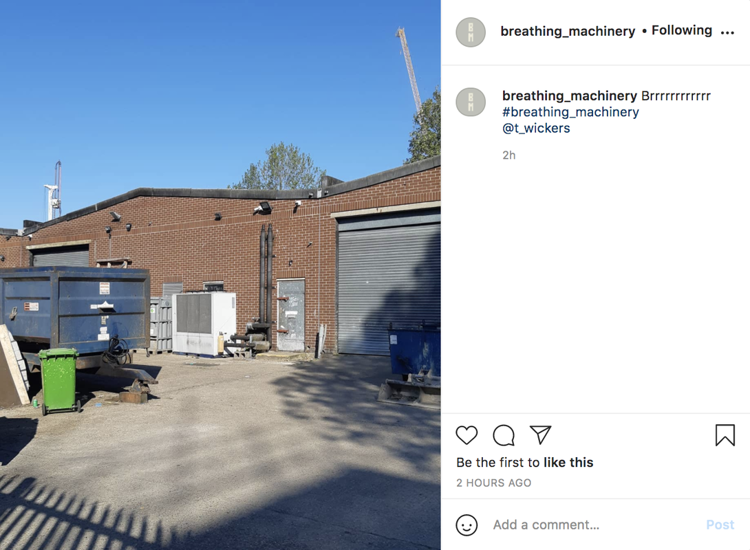 A screen shot of an instagram post. Image of an industrial building with extractor fan unit on the outside. Text:
